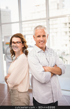 Smiling casual business colleagues with arms crossed stock photo, Portrait of smiling casual business colleagues with arms crossed in the office by Wavebreak Media
