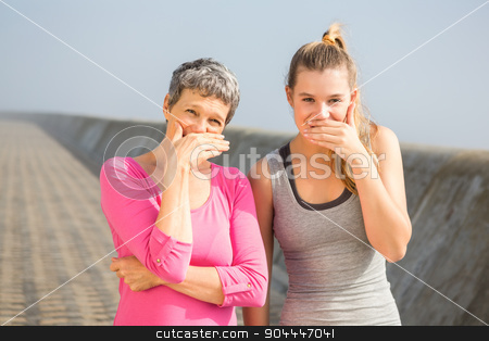 Sporty mother and daughter laughing stock photo, Portrait of sporty mother and daughter laughing at promenade by Wavebreak Media