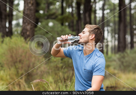 Young handsome man drinking water stock photo, Young handsome man drinking water in the nature by Wavebreak Media