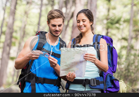 Happy hikers looking at map stock photo, Happy hikers looking at map in the nature by Wavebreak Media