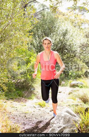Blonde athlete jogging on trail stock photo, Blonde athlete jogging on trail in the nature by Wavebreak Media