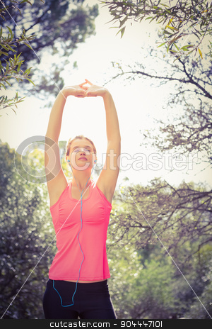 Blonde athlete stretching arms with eyes closed stock photo, Blonde athlete stretching arms with eyes closed in the nature by Wavebreak Media