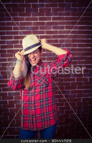 Beautiful hipster having fun stock photo, Beautiful hipster having fun on red brick background by Wavebreak Media