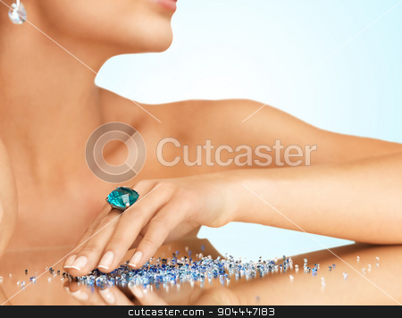 hand with cocktail ring on the mirror stock photo, woman's hand with cocktail ring on the mirror by Syda Productions