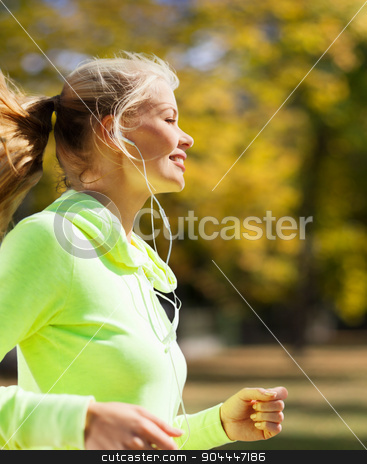 woman doing running outdoors stock photo, sport and lifestyle concept - woman doing running outdoors by Syda Productions