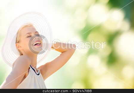 beautiful woman enjoying summer outdoors stock photo, fashion, happiness and lifestyle concept - beautiful woman in hat enjoying summer outdoors by Syda Productions