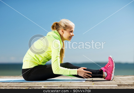 woman doing sports outdoors stock photo, fitness and lifestyle concept - woman doing sports outdoors by Syda Productions