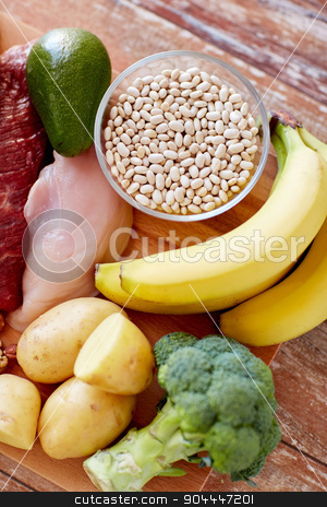 close up of different food items on table stock photo, balanced diet, cooking, culinary and food concept - close up of different food items on wooden table by Syda Productions