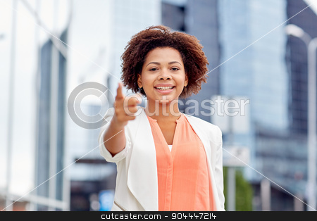 happy african businesswoman pointing finger on you stock photo, business, gesture, hiring and people concept - young smiling african american businesswoman pointing finger on you in city by Syda Productions