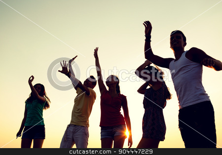 smiling friends dancing on summer beach stock photo, friendship, summer vacation, holidays, party and people concept - group of smiling friends dancing on beach by Syda Productions