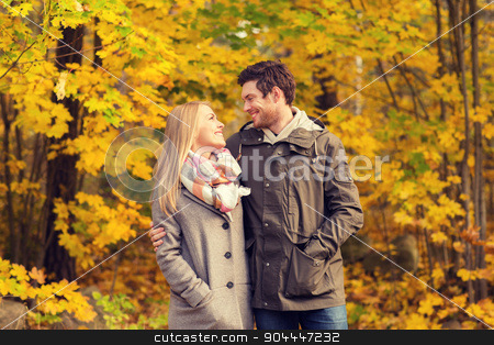smiling couple hugging in autumn park stock photo, love, relationship, family and people concept - smiling couple hugging in autumn park by Syda Productions