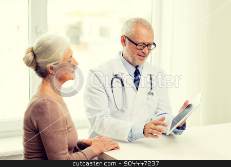 smiling senior woman and doctor with tablet pc stock photo, medicine, age, health care and people concept - smiling senior woman and doctor with tablet pc computer meeting in medical office by Syda Productions
