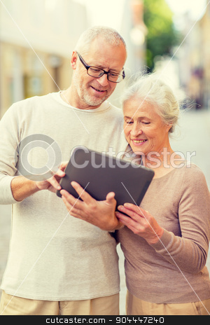 senior couple photographing on city street stock photo, age, tourism, travel, technology and people concept - senior couple with tablet pc computer on street by Syda Productions