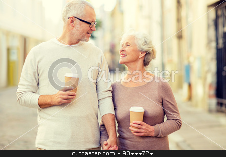 senior couple on city street stock photo, family, age, tourism, travel and people concept - senior couple on city street by Syda Productions