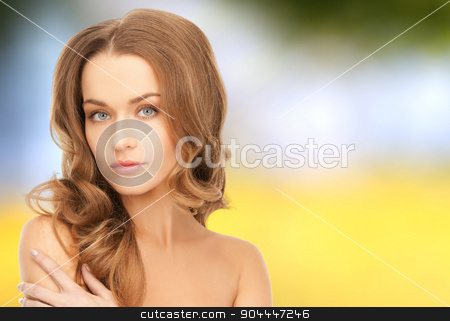 beautiful young woman with bare shoulders stock photo, beauty, people and health concept - beautiful young woman with bare shoulders over yellow autumn background by Syda Productions
