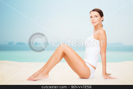 beautiful woman in cotton underwear stock photo, people, beauty, spa and resort concept - beautiful woman in cotton underwear over infinity edge pool background by Syda Productions