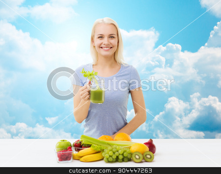 smiling woman drinking juice or shake over sky stock photo, healthy eating, vegetarian food, diet, detox and people concept - smiling woman drinking green vegetable juice or shake from glass over blue sky and clouds background by Syda Productions