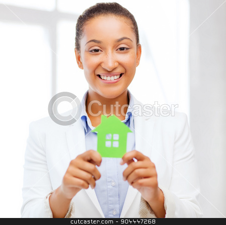african woman holding green paper house stock photo, office, business, eco, power saving and real estate concept - african woman holding green paper house by Syda Productions