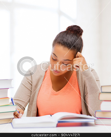 international student studying in college stock photo, education and business concept - international student studying in college by Syda Productions