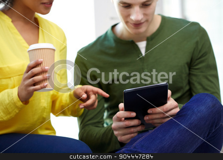 close up of students with tablet pc and coffee stock photo, education, technology, people and internet concept - close up of students with tablet pc computer and coffee cup at school by Syda Productions