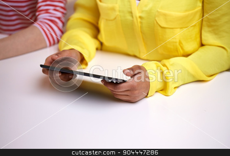 close up of female hands with tablet pc at table stock photo, people, technology and internet concept - close up of african american female hands with tablet pc at table by Syda Productions