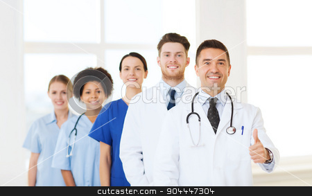 group of happy doctors at hospital stock photo, hospital, profession, people and medicine concept - group of happy doctors at hospital showing thumbs up gesture by Syda Productions