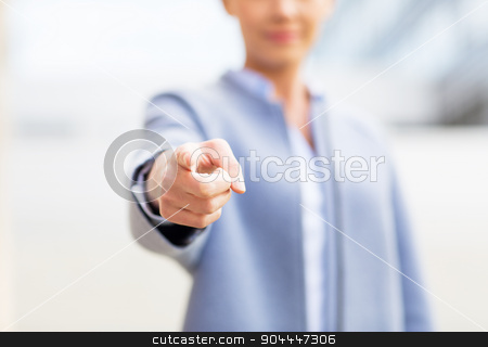 young smiling businesswoman over office building stock photo, business and people concept - young smiling businesswoman over office building by Syda Productions