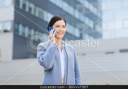 young smiling businesswoman calling on smartphone stock photo, business and people concept - young smiling businesswoman calling on smartphone over office building by Syda Productions