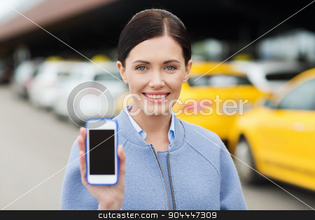 smiling woman showing smartphone over taxi in city stock photo, travel, business trip, people and tourism concept - smiling young woman showing smartphone blank screen over taxi station or city street by Syda Productions