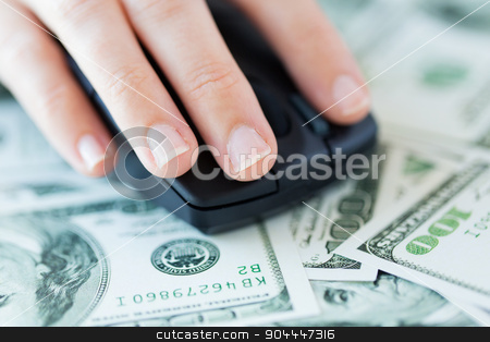 close up of hand with computer mouse on money stock photo, business, finance, internet earning and people concept - close up of hand with computer mouse on money by Syda Productions