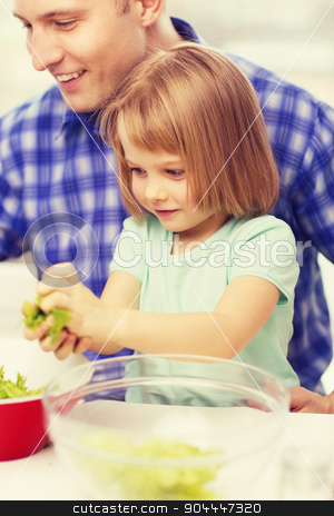 smiling father and little girl at kitchen stock photo, family, child, food and home concept - smiling father and little girl at kitchen cooking salad by Syda Productions