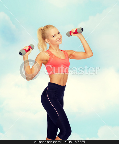 smiling beautiful sporty woman with dumbbells stock photo, fitness, sport and diet concept - smiling beautiful sporty woman with dumbbells by Syda Productions