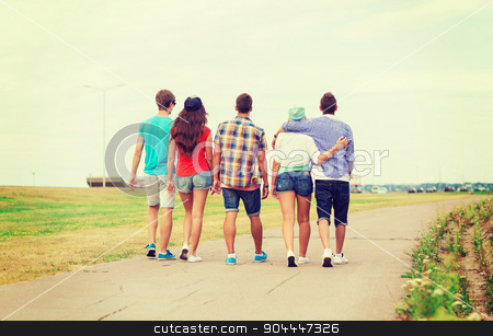 group of teenagers walking outdoors from back stock photo, holidays, vacation, love and friendship concept - group of teenagers walking outdoors from back by Syda Productions