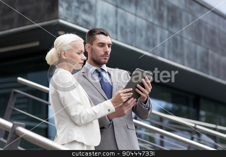 businesspeople with tablet pc outdoors stock photo, business, partnership, technology and people concept - businessman and businesswoman working with tablet pc computer on city street by Syda Productions
