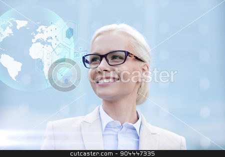 young smiling businesswoman in eyeglasses outdoors stock photo, business, people, technology and education concept - young smiling businesswoman in eyeglasses with virtual screens and globe hologram outdoors by Syda Productions