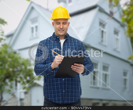 smiling male builder in helmet with clipboard stock photo, repair, construction, building, people and maintenance concept - smiling male builder or manual worker in helmet with clipboard taking notes over living house background by Syda Productions