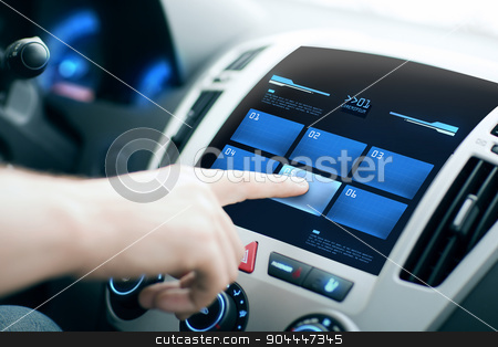 hand pushing button on car control panel screen stock photo, transport, modern technology and people concept - male hand pushing button on car control panel screen by Syda Productions