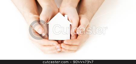 man and woman hands with white paper house stock photo, real estate and family home concept - closeup picture of male and female hands holding white blank paper house by Syda Productions