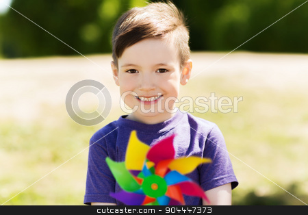 happy little boy with colorful pinwheel at summer stock photo, summer, childhood, leisure and people concept - happy little boy with colorful pinwheel toy outdoors by Syda Productions