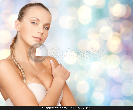 beautiful young woman with bare shoulders stock photo, beauty, people and body care concept - beautiful young woman with bare shoulders over blue holidays lights background by Syda Productions