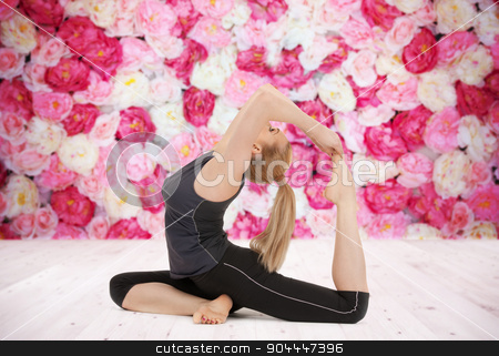 happy young woman doing yoga exercise stock photo, sport, fitness, yoga, people and health concept - happy young woman doing headstand exercise on wooden floor over wall of flowers background by Syda Productions