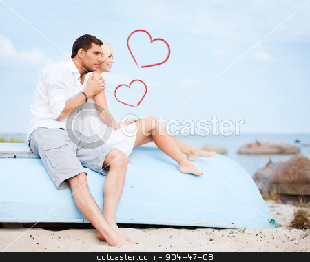 couple sitting on boat at sea side stock photo, summer holidays and dating concept - couple sitting on boat at sea side by Syda Productions