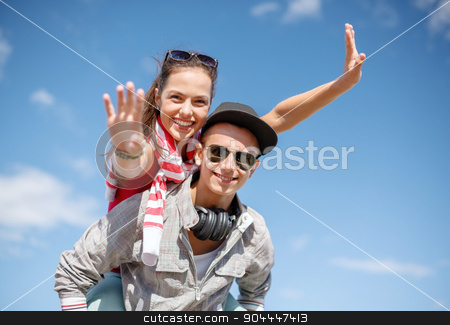 smiling teenagers in sunglasses having fun outside stock photo, summer holidays, relationships and teenage concept - smiling teenagers in sunglasses having fun outside by Syda Productions