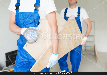 close up of builders carrying wooden boards stock photo, building, carpentry, repair, teamwork and people concept - close up of builders carrying wooden boards by Syda Productions