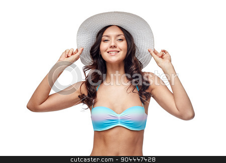 happy young woman in bikini swimsuit and sun hat stock photo, people, fashion, summer and beach concept - happy young woman in bikini swimsuit and sun hat by Syda Productions