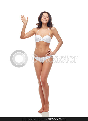 happy young woman in white swimsuit waving hand stock photo, people, fashion, swimwear, summer and beach concept - happy young woman in white bikini swimsuit waving hand by Syda Productions