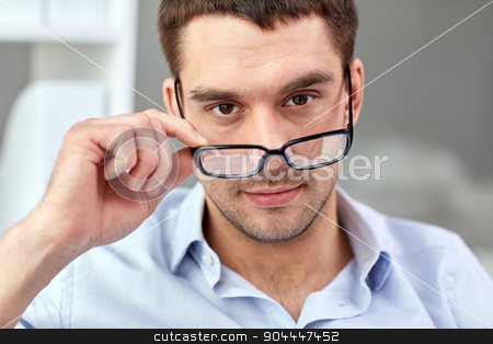 portrait of businessman in eyeglasses at office stock photo, business, people and work concept - portrait of businessman in eyeglasses at office by Syda Productions