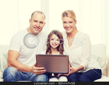 parents and little girl with laptop at home stock photo, family, child, technology and home concept - smiling parents and little girl with laptop at home by Syda Productions