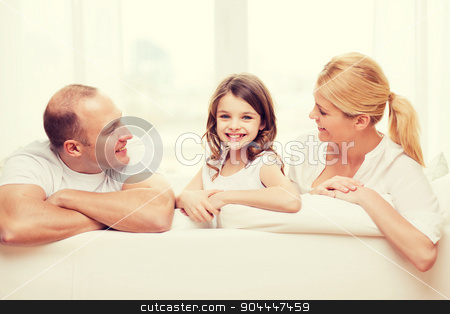 smiling parents and little girl at home stock photo, family, child and home concept - smiling parents and little girl at home by Syda Productions