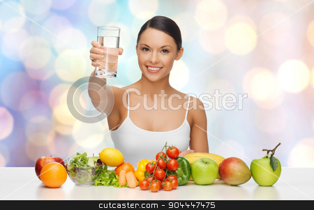 happy woman with healthy food showing water glass stock photo, people, diet and vegetarian concept - happy asian woman with healthy food showing glass of water over blue lights background by Syda Productions